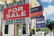 For Sale Signs and Sold Signs on Houses (14599886)
