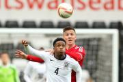 NEW CAMPAIGN: Newport's Lee Evans in action for Wales under-21s against Nat Chalobah of England last year