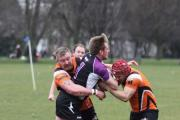 The Torfaen Tigers defence muscles up.