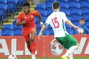 RARE START: Newport's Ellis Harrison in action for Wales under-21s this week