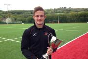 GREAT SEASON: Dragons flyer Hallam Amos with the Argus readers' player of the season trophy