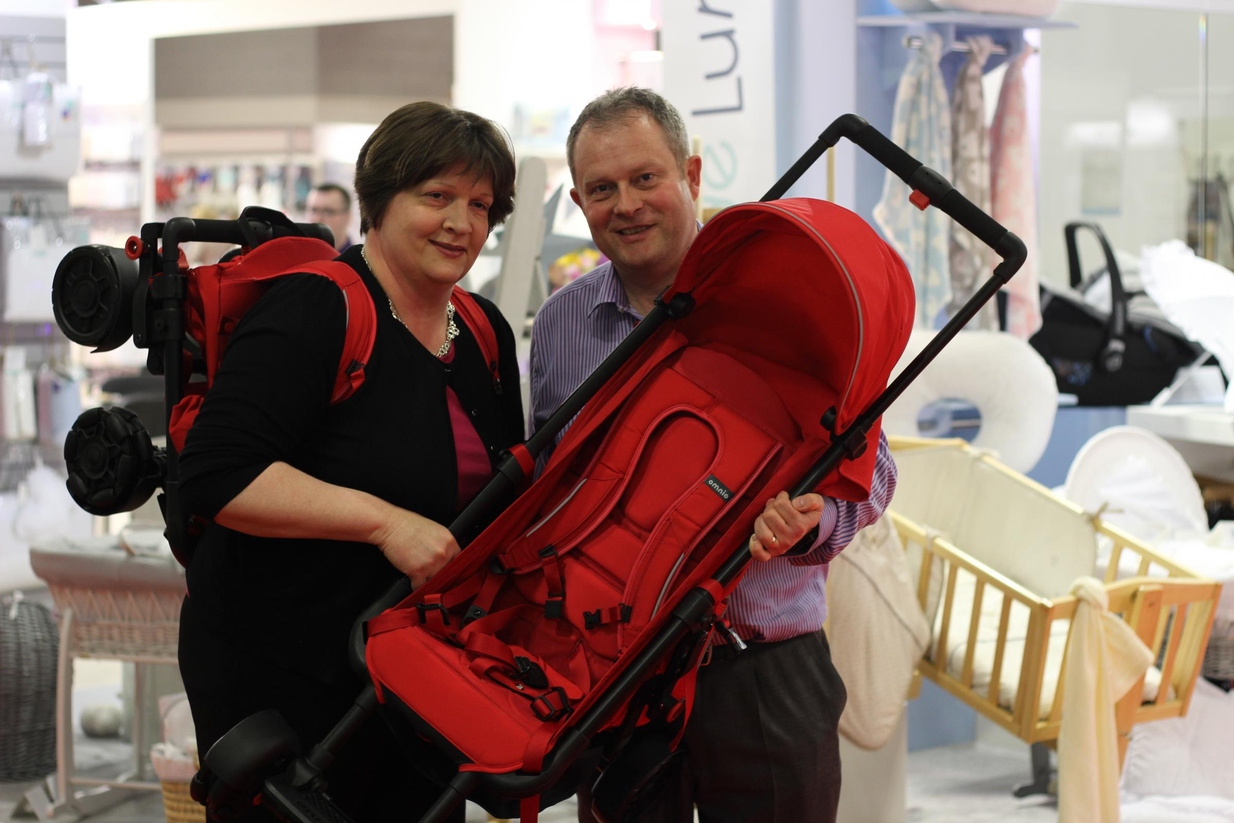Markus and Samantha Warwick  with Omnio, the wearable stroller