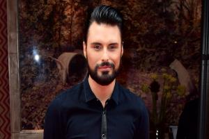 Rylan Clark-Neal got stuck in a lift for nearly an HOUR and shared the ordeal in a hilarious series of Twitter posts