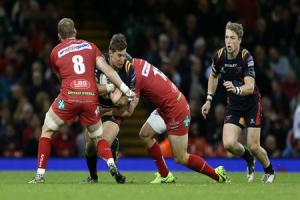 JUDGEMENT CLASH: Full-back Carl Meyer charges into Test players John Barclay and Jonathan Davies for the Dragons against the Scarlets