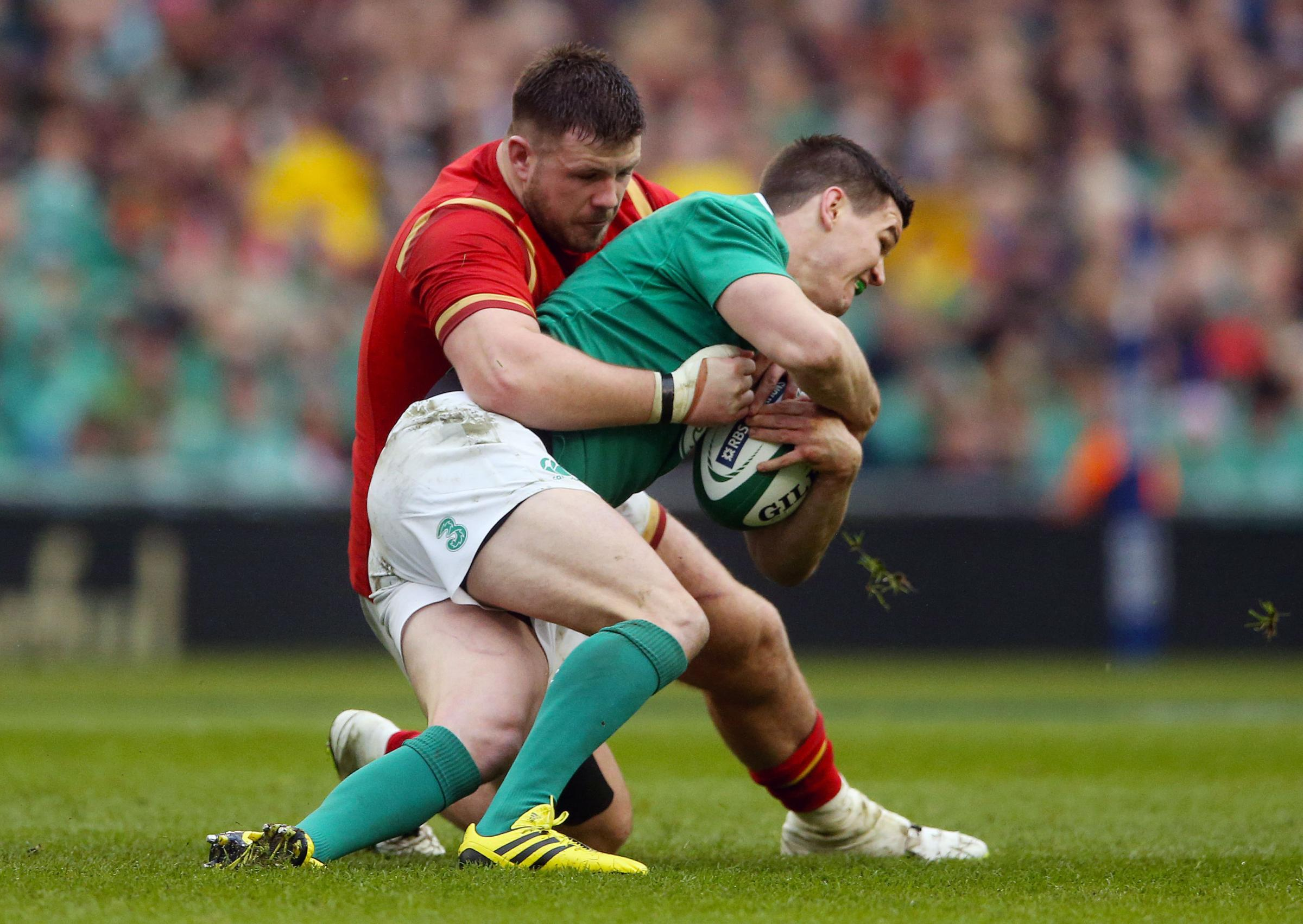 Rob Evans seen here tackling Jonny Sexton will replace Wyn Jones at loosehead to play against Argentina.