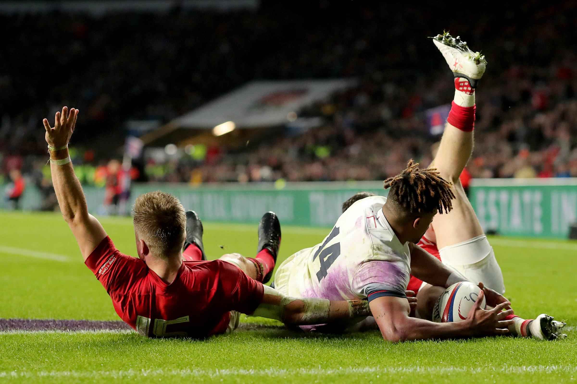 World Rugby say Gareth Anscombe, left, should have been awarded a try against England by the TMO (Gareth Fuller/PA)