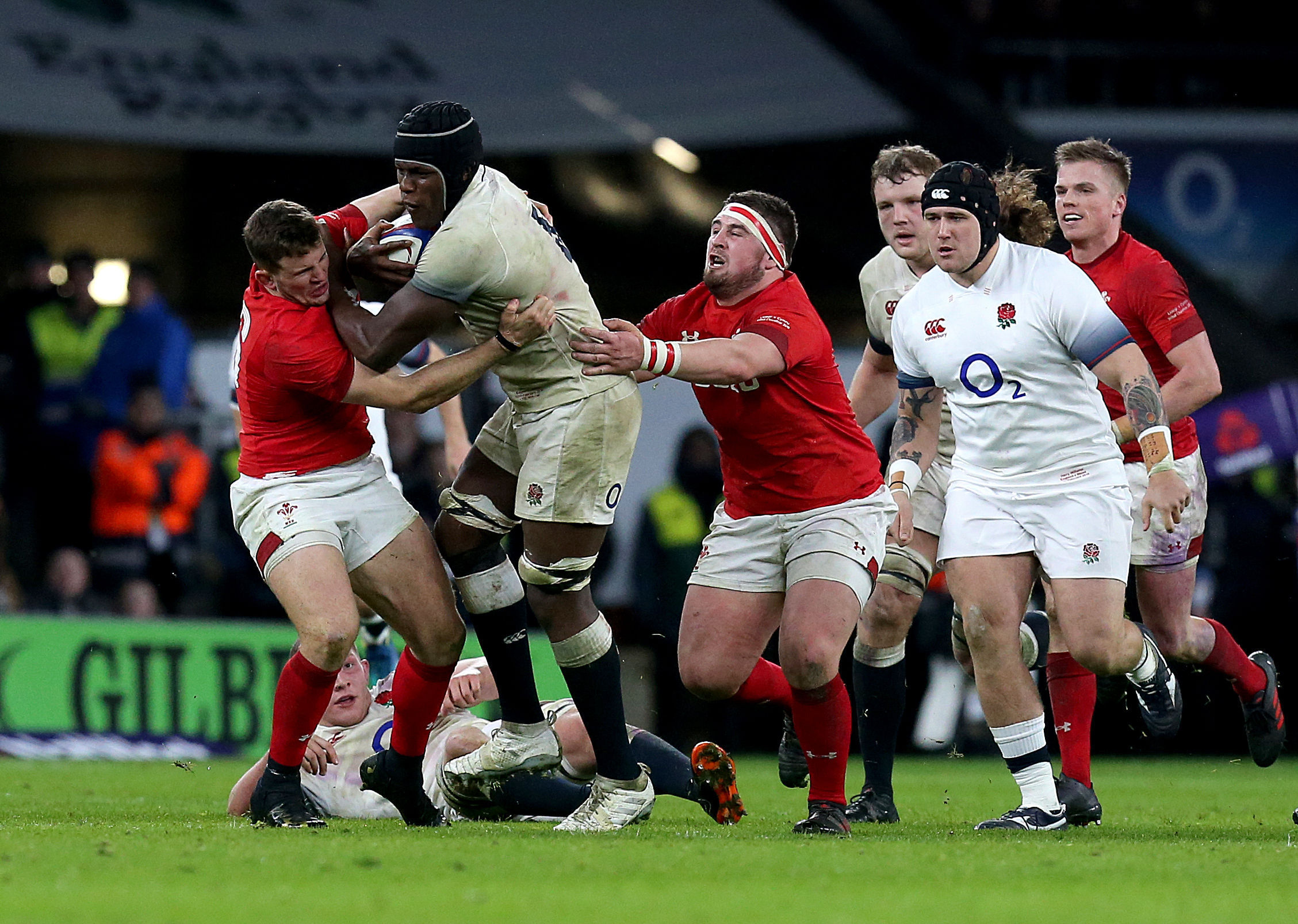CHANCE TO SHINE: Dragons hooker Elliot Dee, pictured tackling Maro Itoje at Twickenham, is set to feature for Wales against Tonga