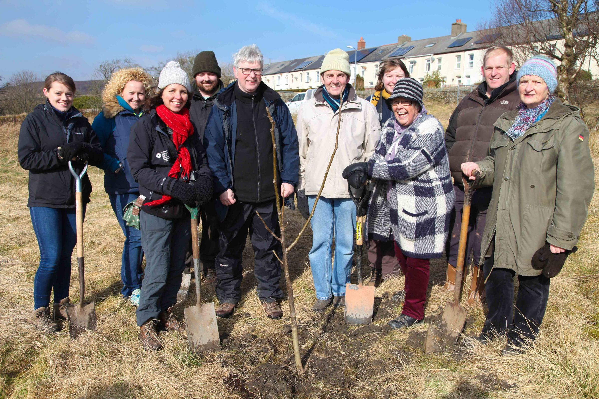 A project to plant a tree for every child born or adopted in Wales has celebrated its tenth anniversary with a planting session at the Garn Lakes Local Nature Reserve in Blaenavon.