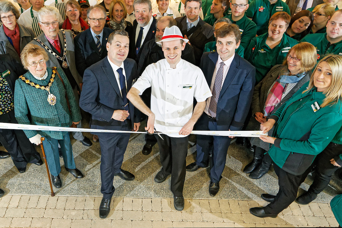Opening of new Morrisons super market in Abergavenny, Wales, UK  Store manager Gavin Anderson (2nd L) with butcher Adrian Edwards and local dignitaries cutting the ribbon