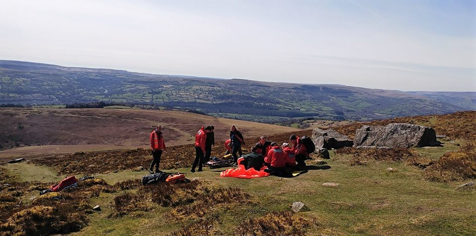 Mountain rescuers come to the aid of a woman at the top of Sugar Loaf. Pictures: Longtown Mountain Rescue Team