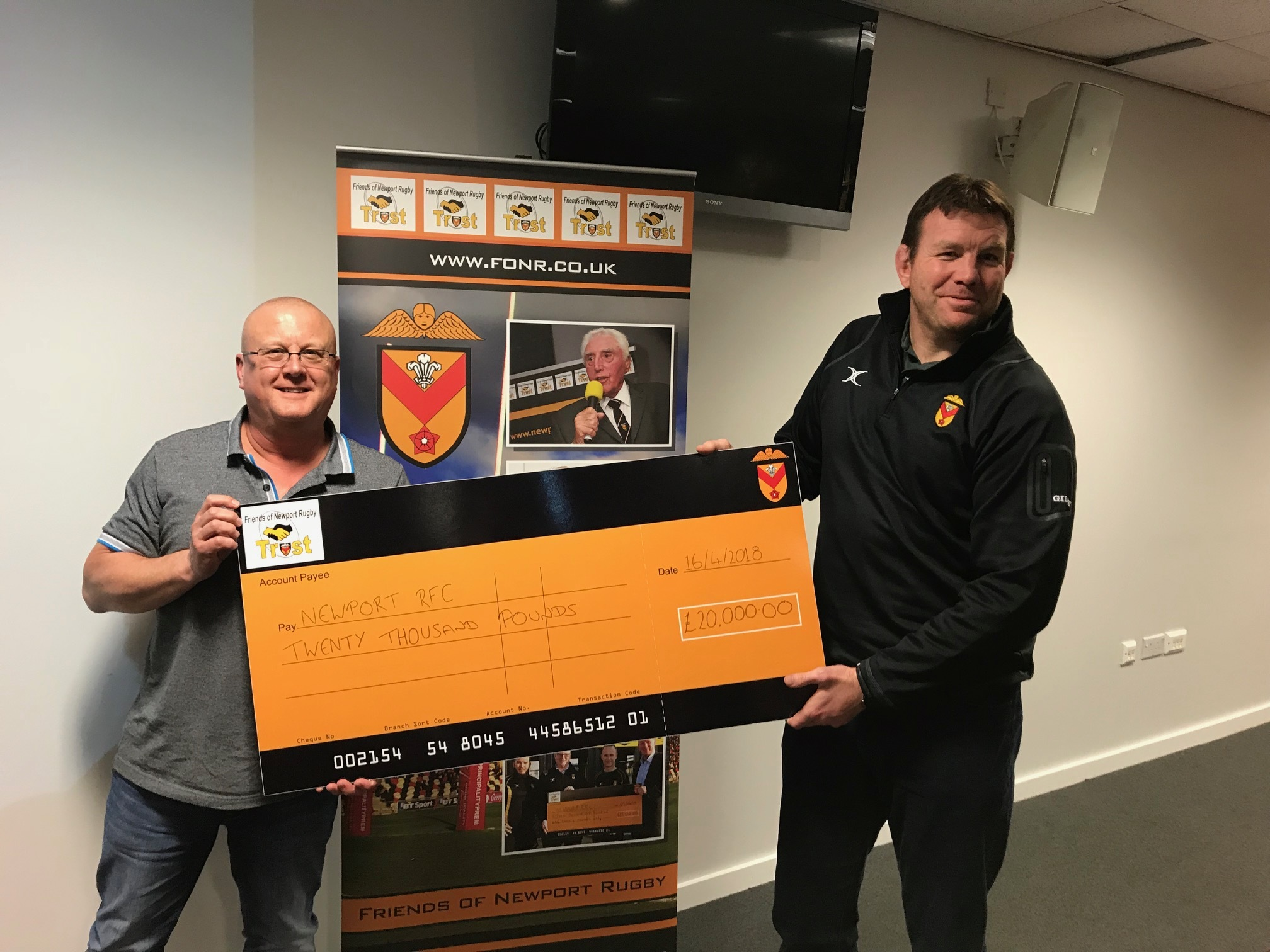 HUGE EFFORT: Friends of Newport Rugby chairman Andrew Hopkins hands over a cheque for £20,000 to team manager Mark Workman