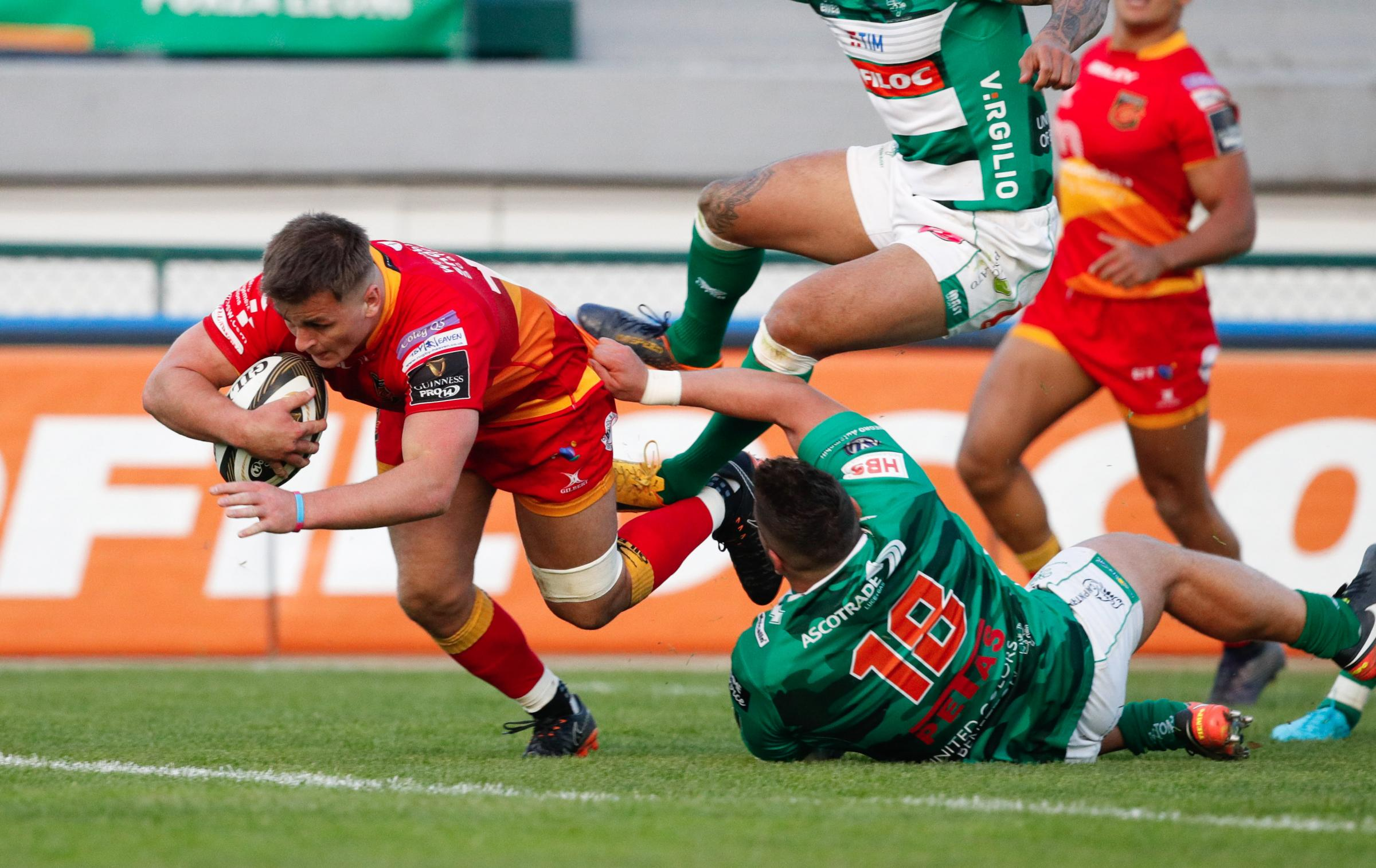TRY TIME: Connor Edwards breaks the tackle of Tiziano Pasquali to score against Benetton
