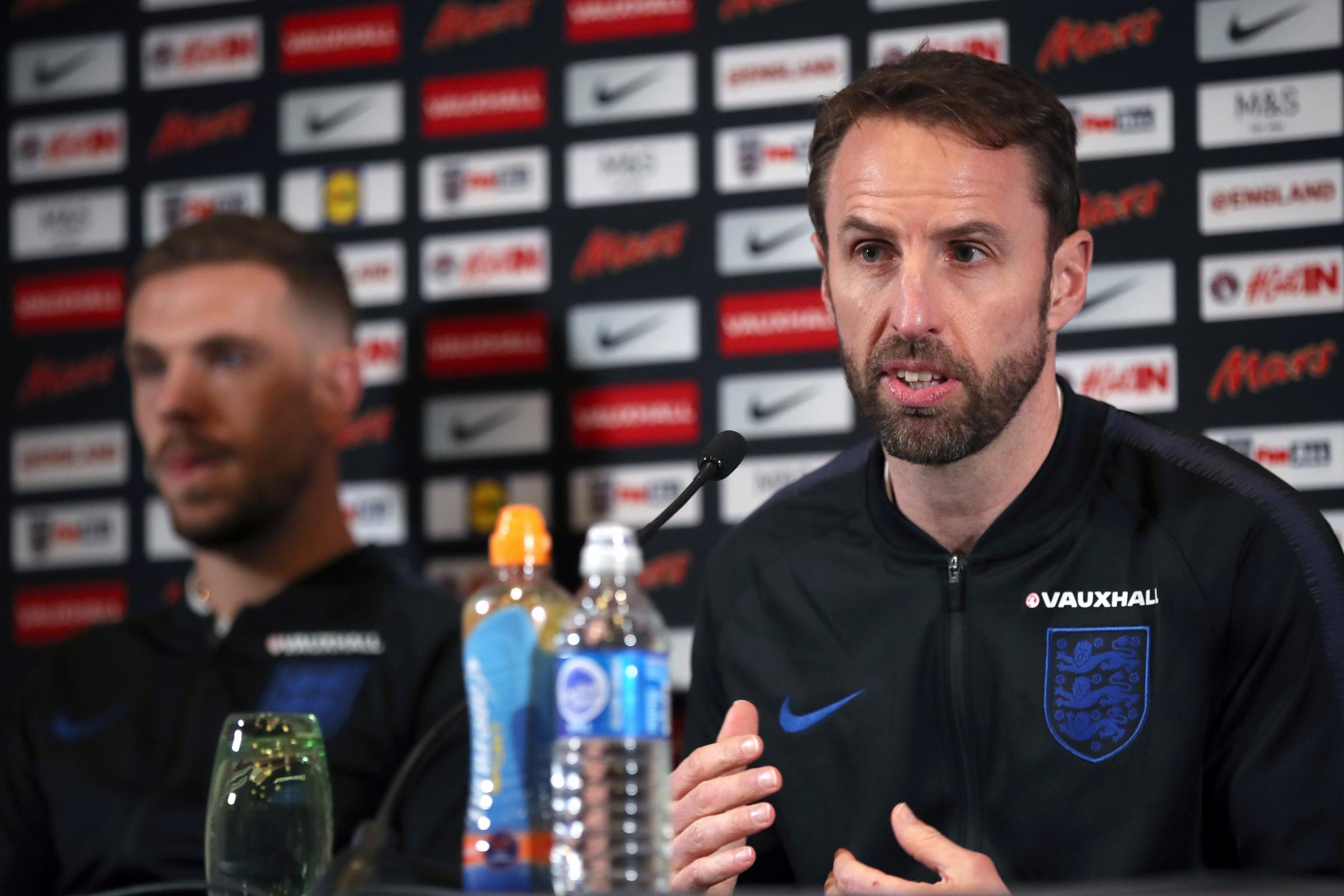 England manager Gareth Southgate, right, wants Jordan Henderson to lead Liverpool to European glory (Nick Potts/PA)