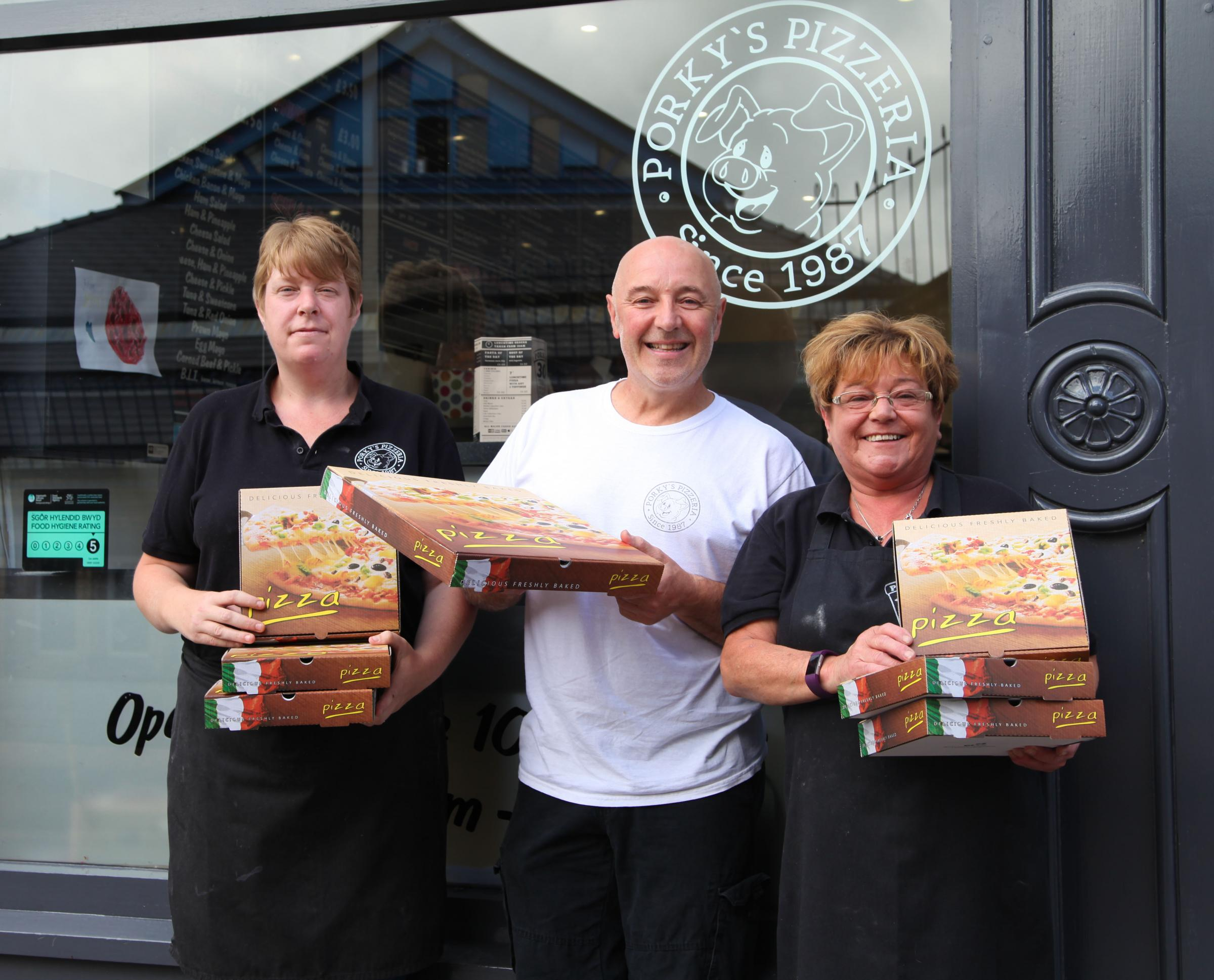 HAPPY: Kerry Dunford, Mike Daley, Sian Jones celebrating a pizzeria's anniversary