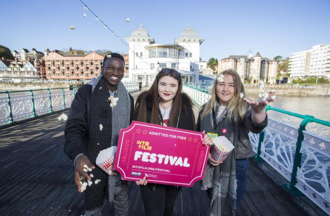 08.11.17 - Into Film Cymru are putting on a free film festival for schools around South Wales - Picture shows Bubacarr from Cardiff with Ruby and Ellie from Cardiff outside Penarth Pavillon Cinema.