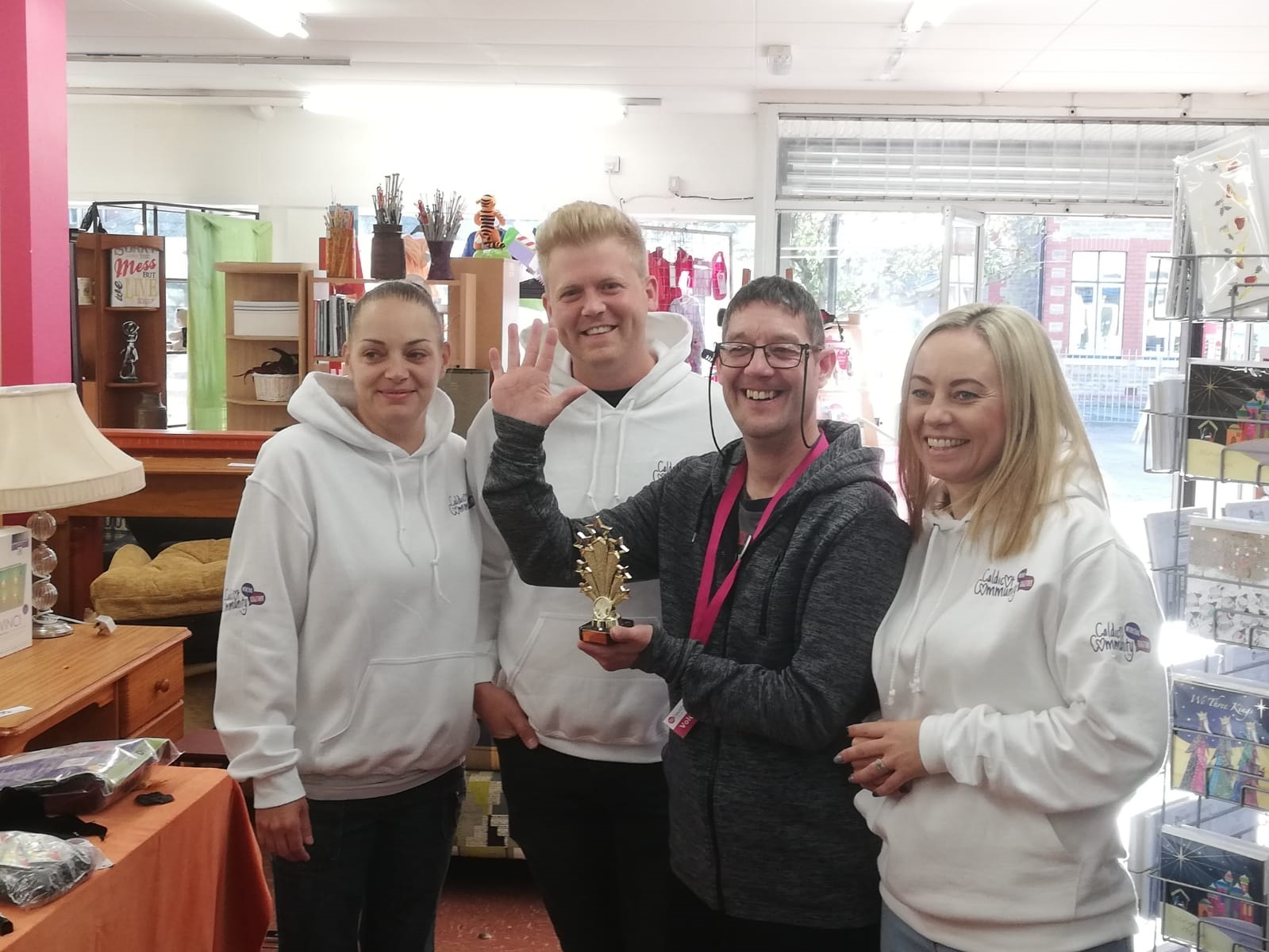 Dean Baker (third from left) after being presented with his trophy by the Caldicot Community Working Together team, from left, Rachel Grumbach, Mathew Clements, and Rachel Furmage