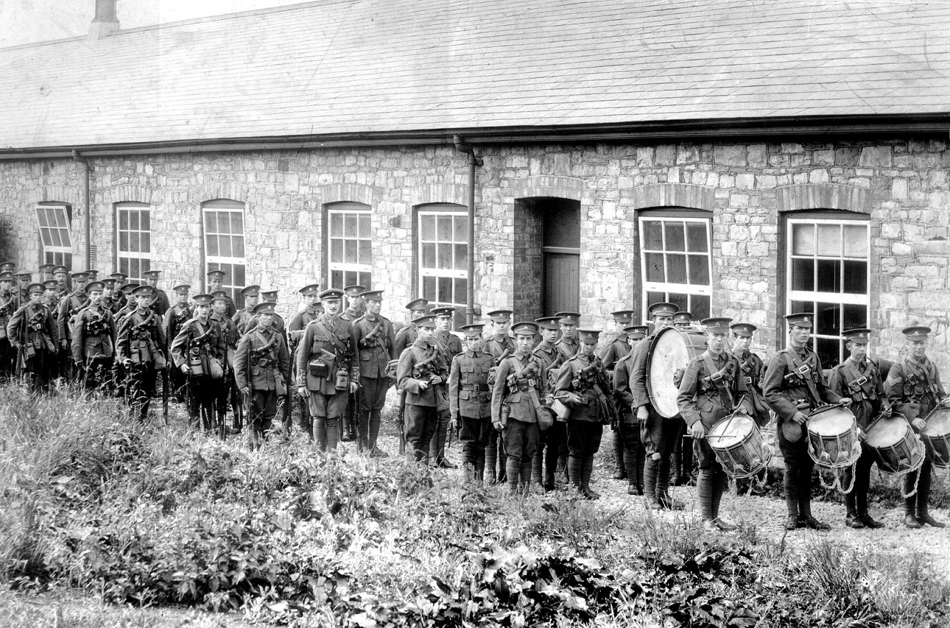 Captain C.A. Evill with his men of the 1st Battalion, the Monmouthshire Regiment, E Company.