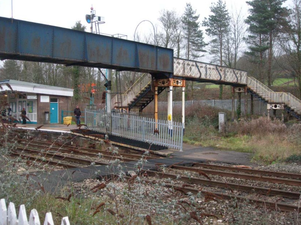RESTORATION: The lattice bridge, which has been removed, at Abergavenny station with the barrow crossing in the foreground. Picture: Network Rail
