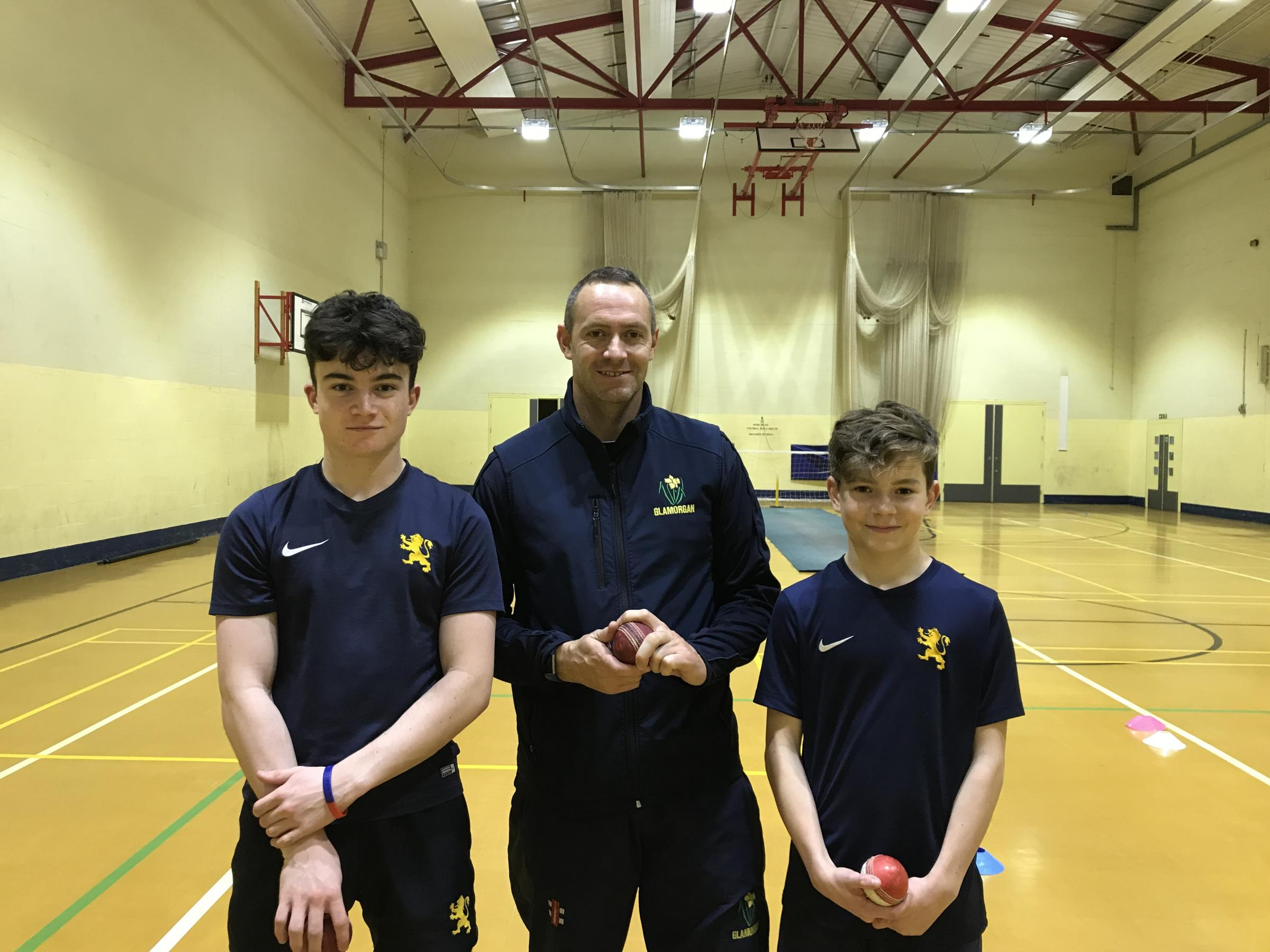 Former Glamorgan star Dean Cosker with Monmouth students Sam Swingwood (left) and Owen Harris.
