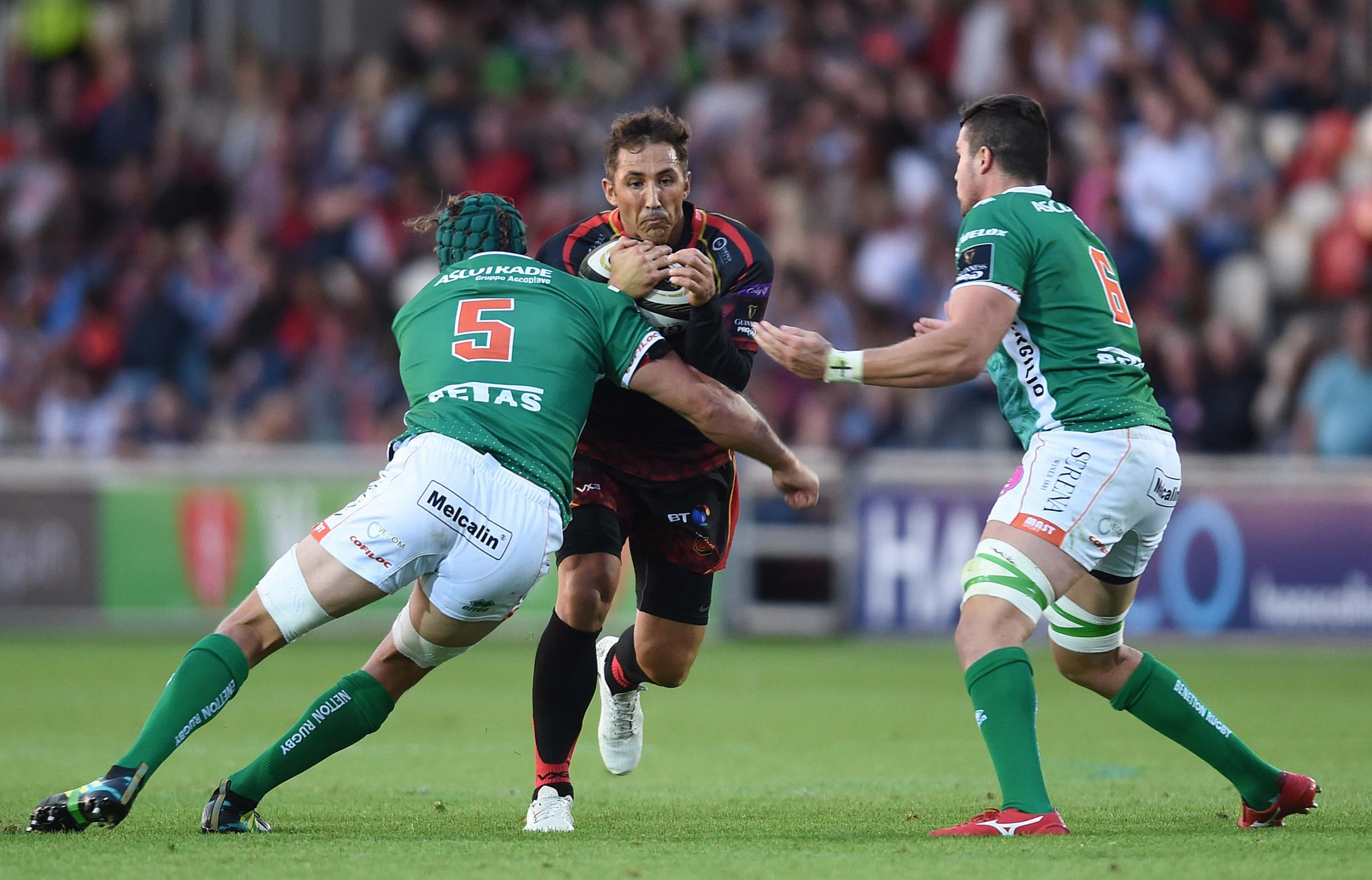 01.09.18 - Dragons v Benetton - Guinness PRO14 -.Gavin Henson of Dragons is tackled by Dean Budd and Alessandro Zanni of Benetton..
