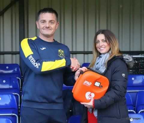 Amanda Smith from the Football Association of Wales (FAW) presented a defibrillator to Cwmbran Celtic's chairman Scott Kinsella. Picture: Steve Roberts