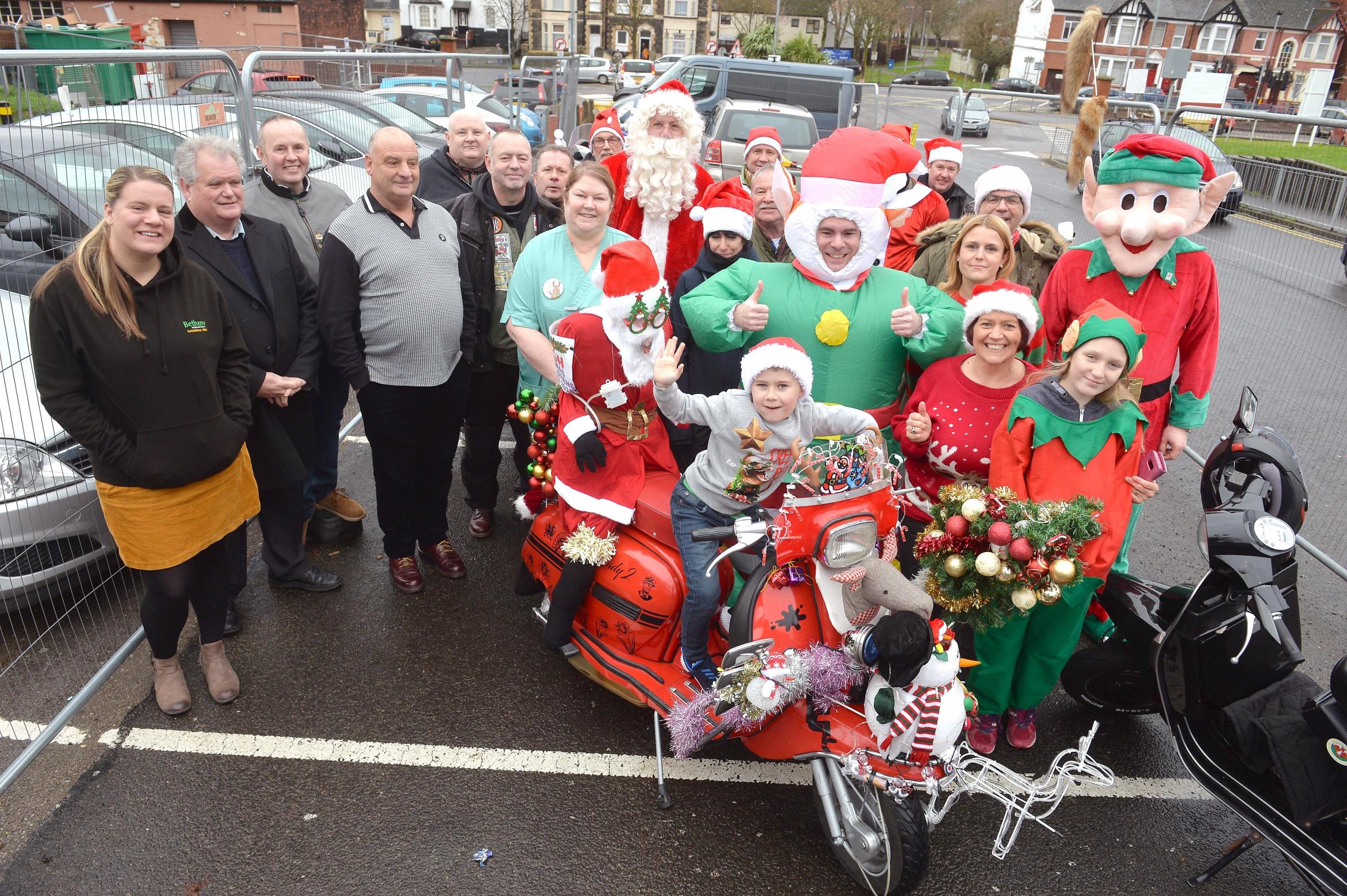 Chepstow Round Table and Cwmbran Scooter Club prepare to give presents to young patients at the Royal Gwent Hospital.