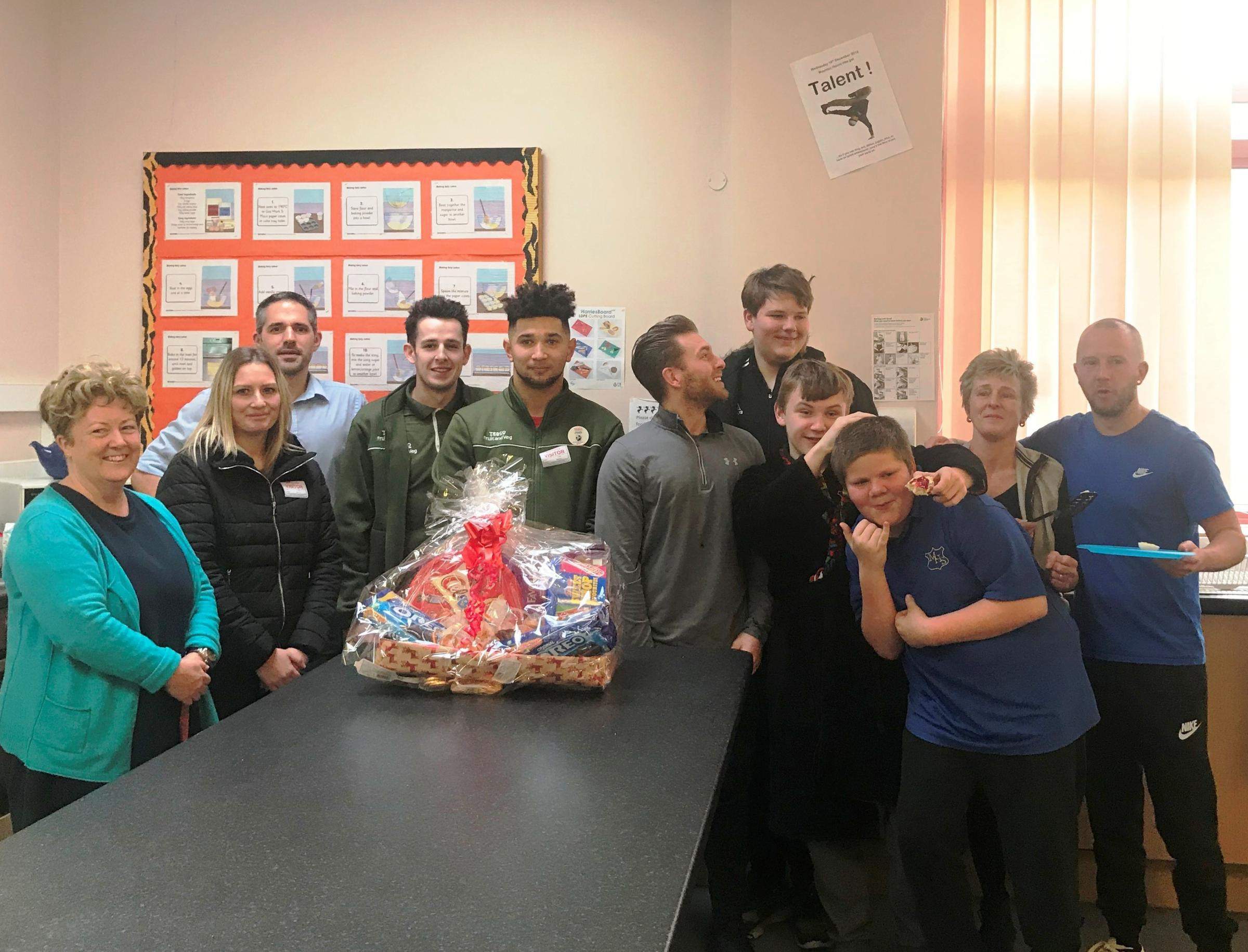Headteacher Beverley Randall (left) with representatives from Tesco's Chepstow store as well as staff and pupils of Mounton House School.