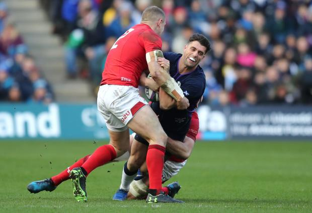 Free Press Series: BIG HIT: Hadleigh Parkes tackles Adam Hastings