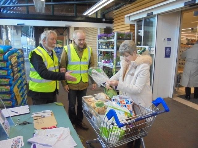 Graham Eele (left) and Tim Melville of Transition Chepstow speak to a shopper about 