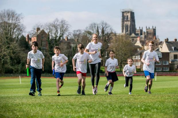 Free Press Series: ON TRACK: Youngsters help Paula Radliffe launch Families on Track (from left) Frazer Ranns, 11, Harry Mason, 9, Sebastian Ranns, 10, Verity Ranns, 9, Emily Smith, 6, and Sam Mason, 12. Picture: SARAH CALDECOTT