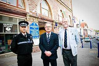 PCC for Gwent Jeff Cuthbert, right, outside the new police contact point at the town hall in Abergavenny
