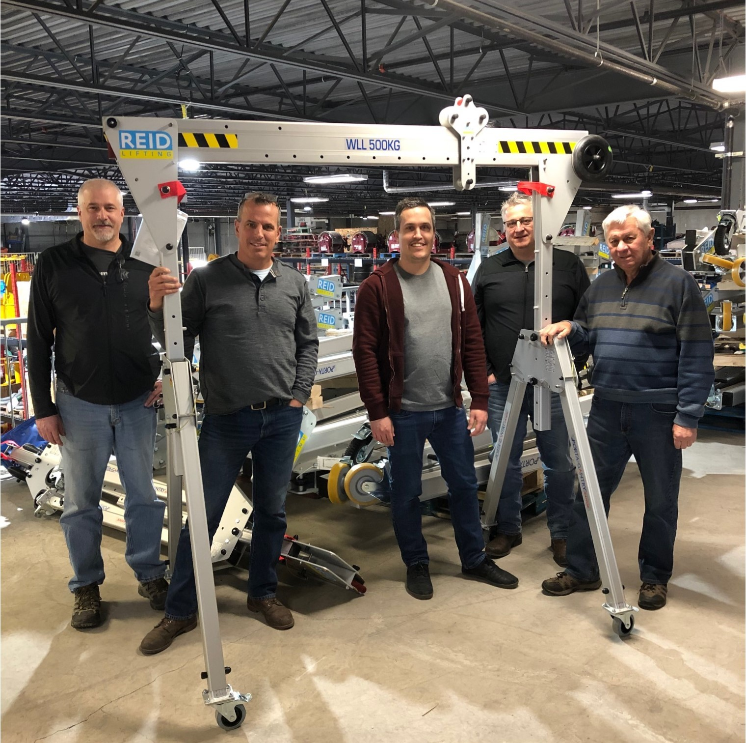 Equipment Corps' Mike Tobola, account manager; Mike Orzel, vice president; Luke Habza, account manager; Dave Kisel, account manager; and Tim Bedard, owner