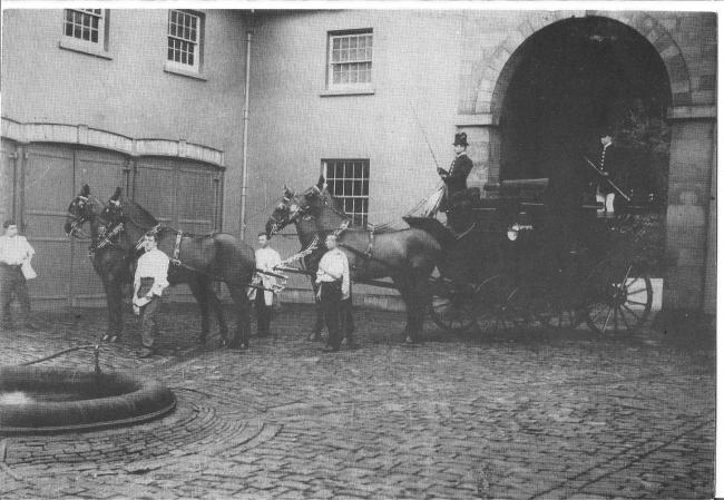 The Hanbury family carriages being driven through the main archway into what is now the museum courtyard. Picture: Torfaen Museum.