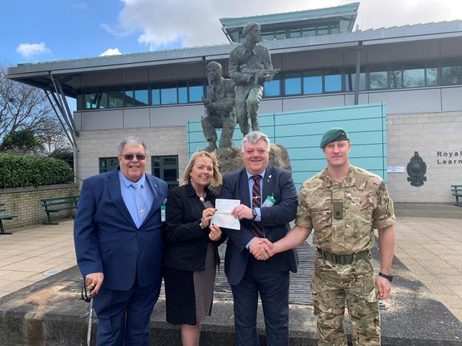 Presentation of cheques to The Royal Marines Charity at the Commandants Courtyard Memorial situated at the front of the headquarters building at CTCRM with Edward Watts, Yvonne Campbell and Richard Hill