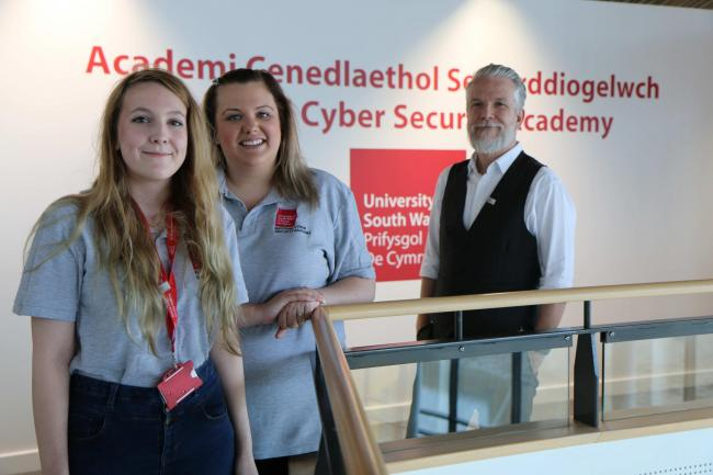 Damon Rands of Wolfberry with cyber students Danielle Kelly and Lisa Cornford who have been on placement at the National Cyber Security Academy