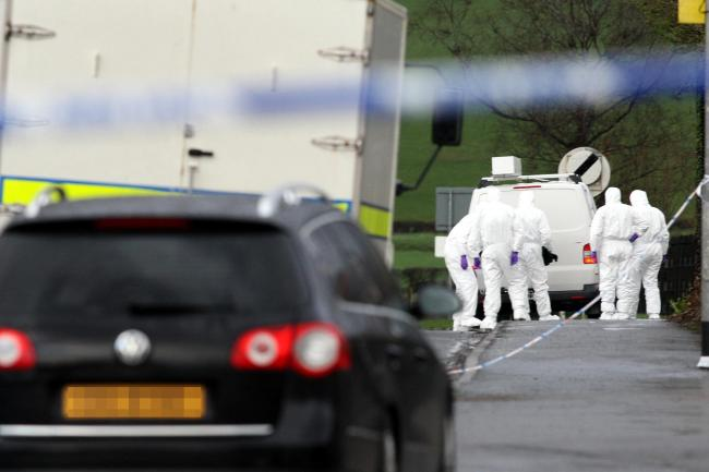 Police forensic experts at the scene where Ronan Kerr died