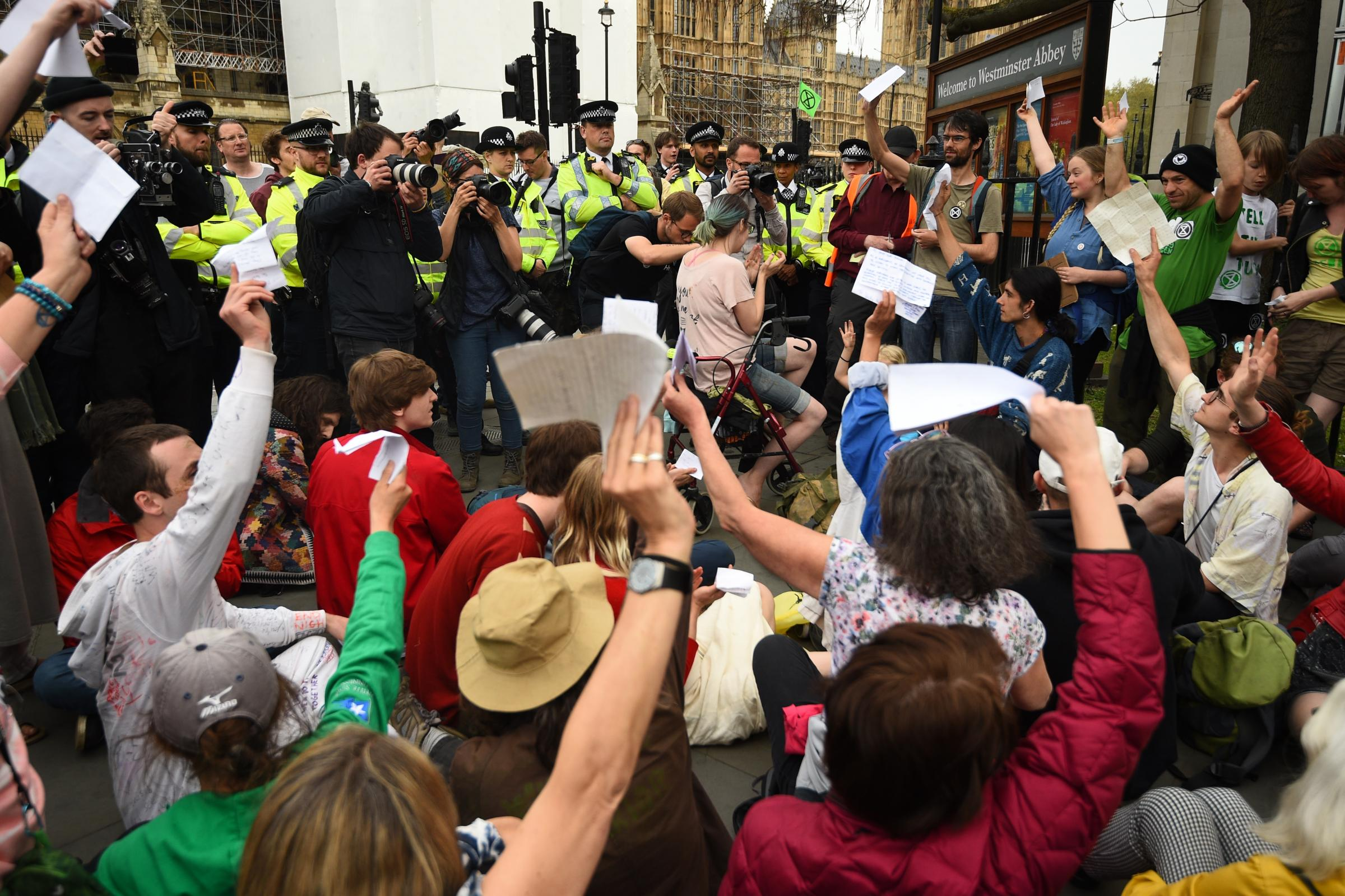 Extinction Rebellion protesters in Westminster hold up letters they have written to their MPs asking for action on climate issues