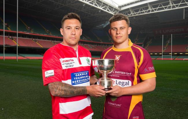 24.04.19 - WRU Finals Day Photocall - Keir Ennis, captain of Oakdale,  left, and Abergavenny captain Ieuan James whose teams will compete in the Bowl Final, during photocall with the trophy ahead of the match.