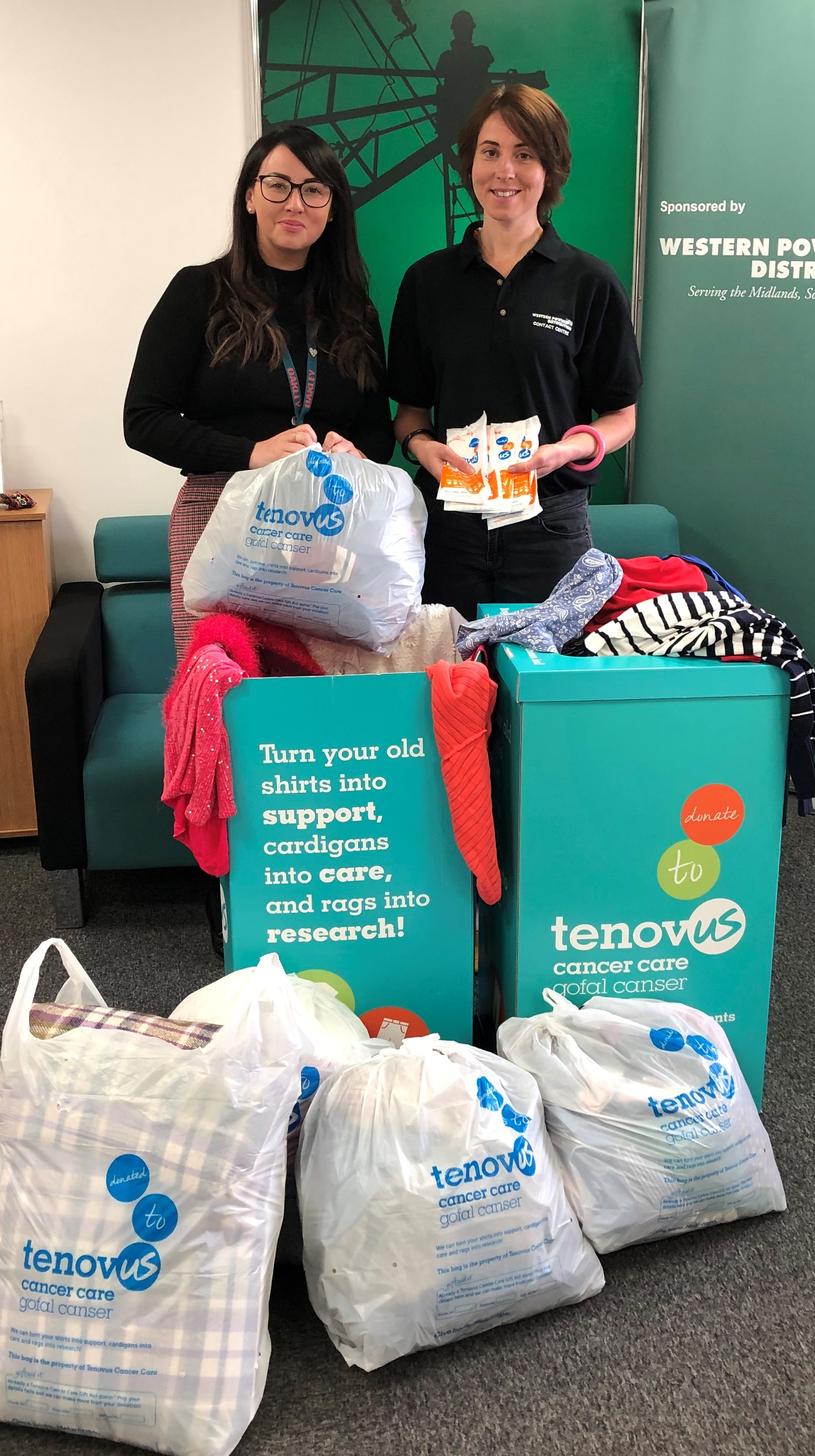 WPD Contact Centre Advisors Lisa Gibson and Fiona Morgan helping to sort out clothing and unwanted items donated by colleagues at WPD's offices
