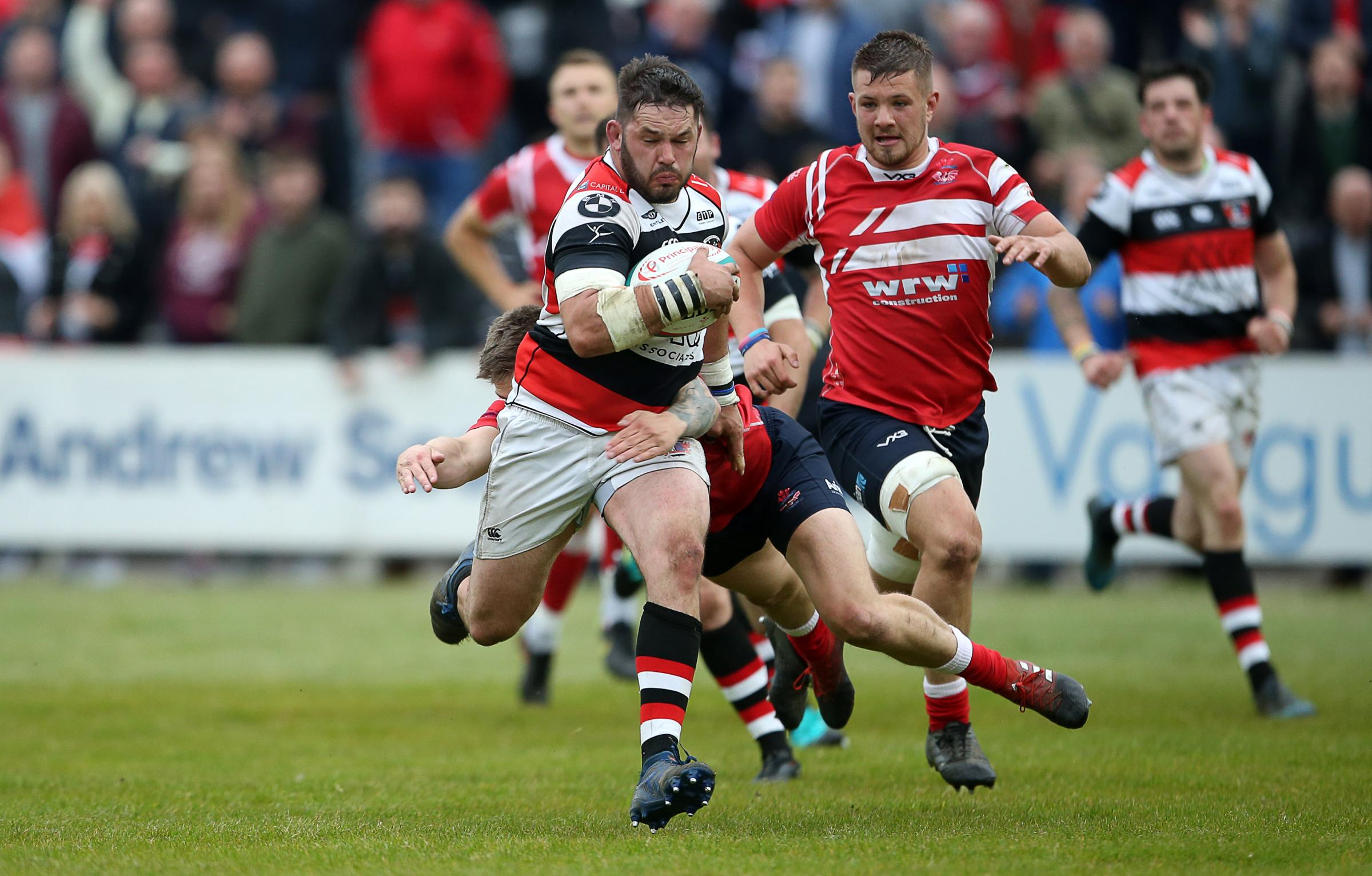 ON THE CHARGE: Pooler's Darren Hughes surges for the try line. Picture: Huw Evans Agency