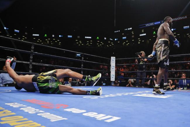 Deontay Wilder, right, knocks down Dominic Breazeale in New York