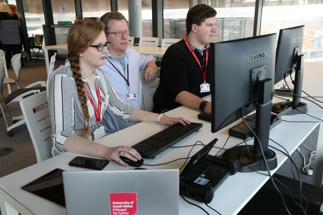 University of South Wales students Jodie Kill and James John with Professor Andrew Blyth in the National Cyber Security Academy..