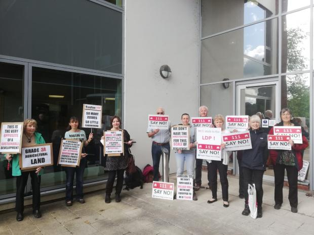 Free Press Series: Members of Raglan Village Action Group outside County Hall on Tuesday ahead of the public hearing.