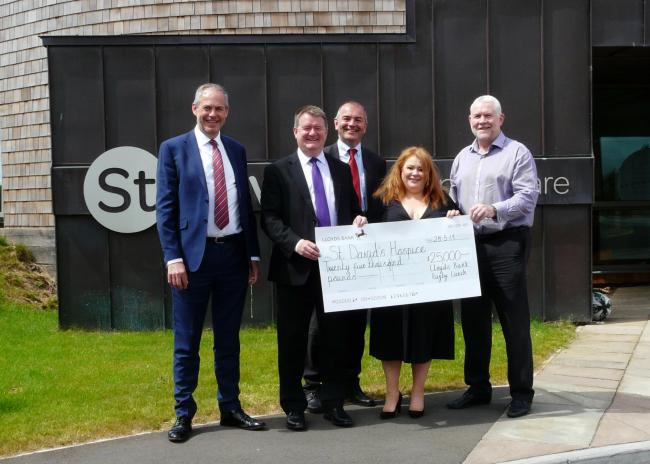 Great pass: Emma Saysell, Chief Executive and Adrian Hadley, Deputy Chief Executive, (right)   of  St David's Hospice Care, receives £25,000 from (l to r)   David Beaumont, Robert Barber, Jonathan Cave, of Lloyds Bank. Picture: DBPR