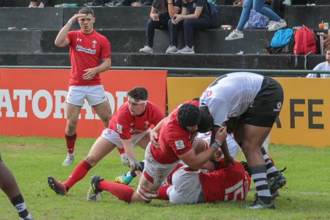 Dragons scrum-half Daf Buckland spreads play for Wales U20s